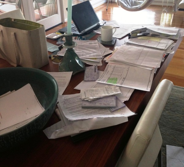 my dining room table in the mountains...finances in disarray