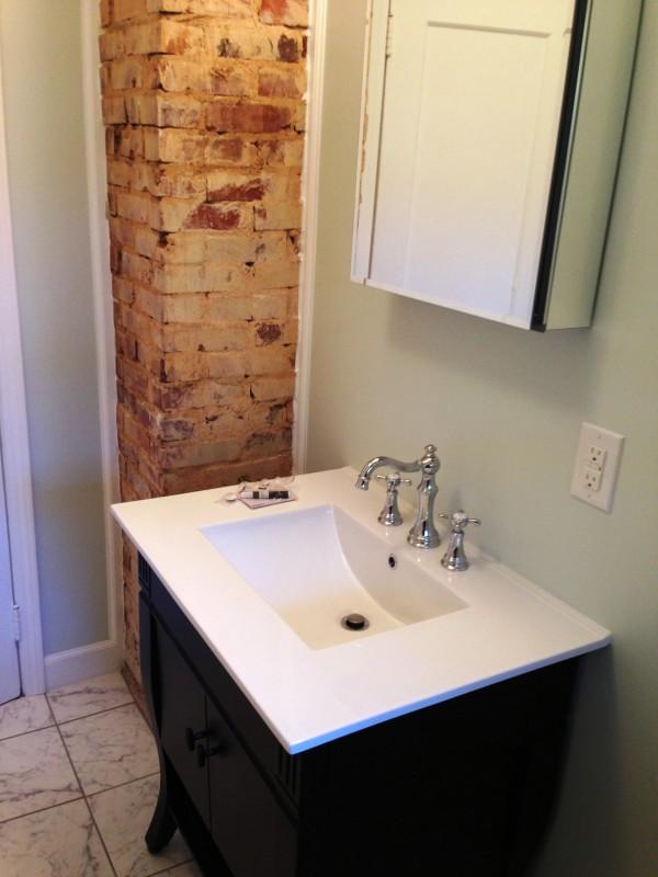 exposed brick in bathroom