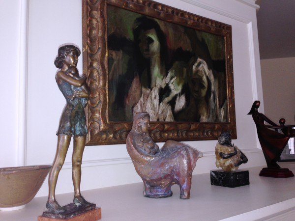 """more Mother and Child sculptures clustered on the TV cabinet """"mantle"""""""