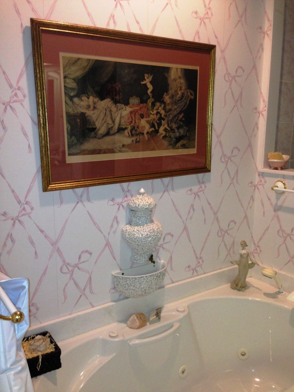 why not formal art and an Italian wall fountain by the bath?