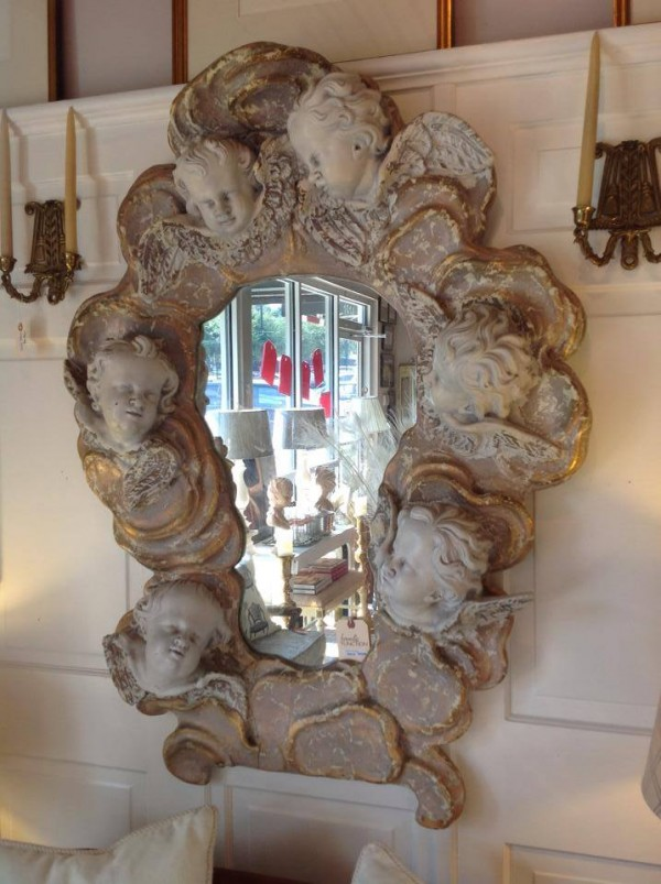 we love the weird too...this cherub head mirror may be creepy to some but not our french girl...