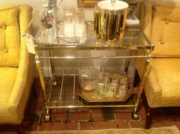 such a functional piece with two shelves and what appears to be two rods at bottom to organize your liquor bottles