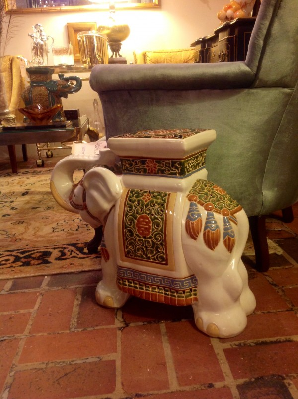 the elephant garden stool is a whimsical addition to the room and serves as an extra perch