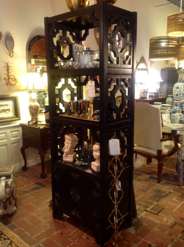 Asian inspired etagere with gorgeous hardware on the lower closed cabinet