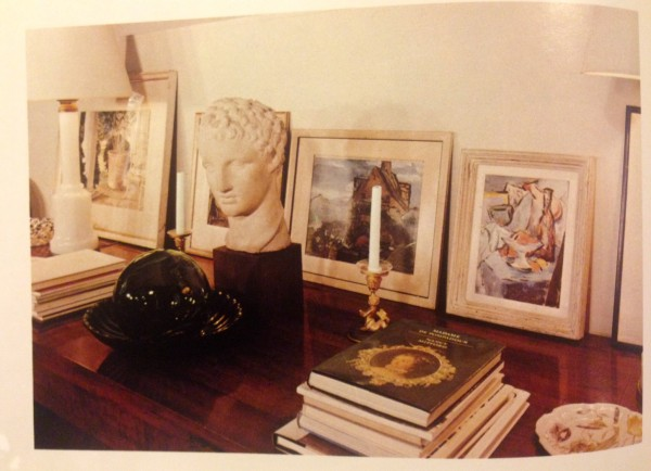white vignette, white walls, art collection