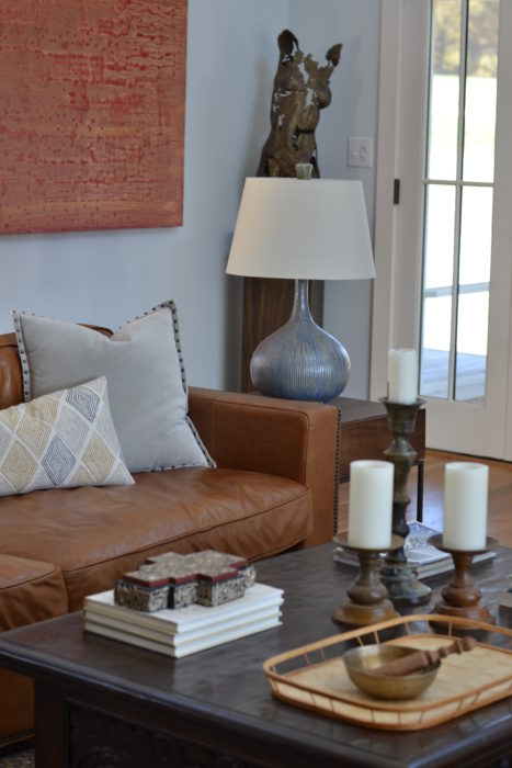 The art is the pop of color in an otherwise understated family room