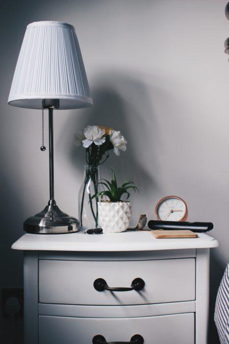 fresh flowers in vase bedroom nightstand