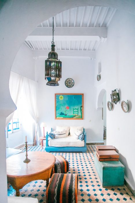 White painted walls colorful art