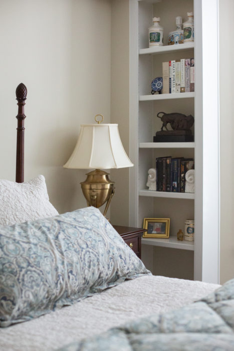 traditional master bedroom built-in bookshelves
