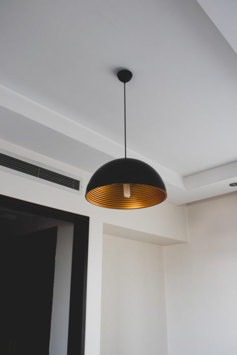 gold black metal light fixture