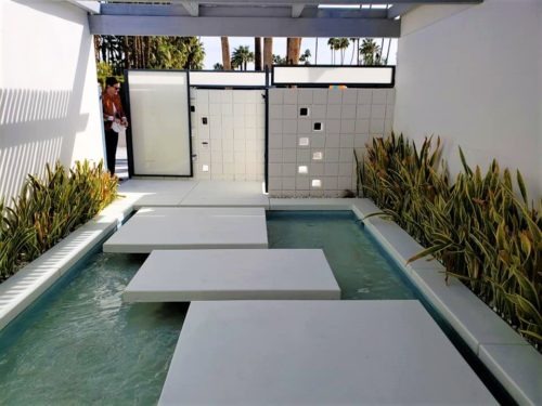 outdoor water feature with walkway over water