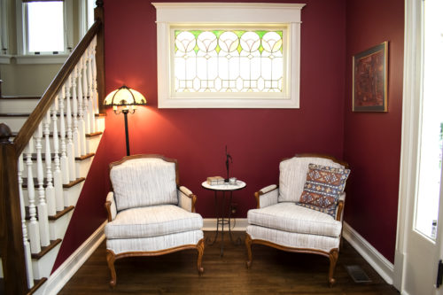 red painted walls french chairs traditional foyer