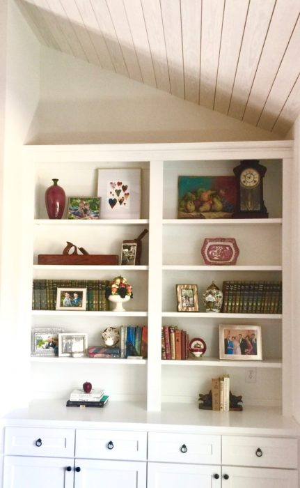 bookshelf styling family mementoes