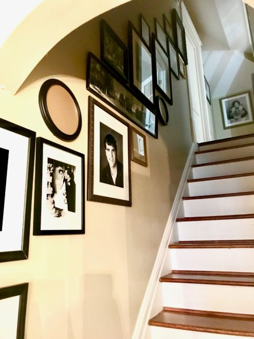 family photo gallery wall art hanging stairwell