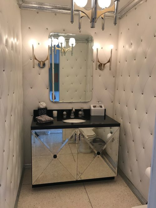 powder room tufted leather walls