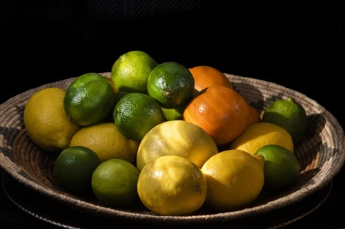 lemons limes oranges in basket
