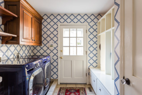 blue and white mudroom spanish house wood cabinets