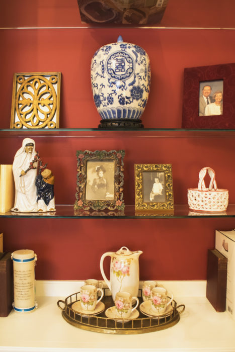 red painted background bookshelves styling