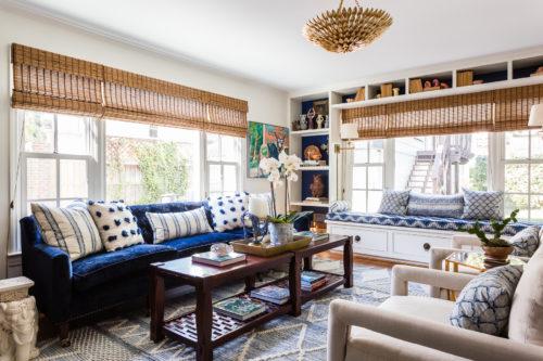 blue and white family room built in bookshelves window seat