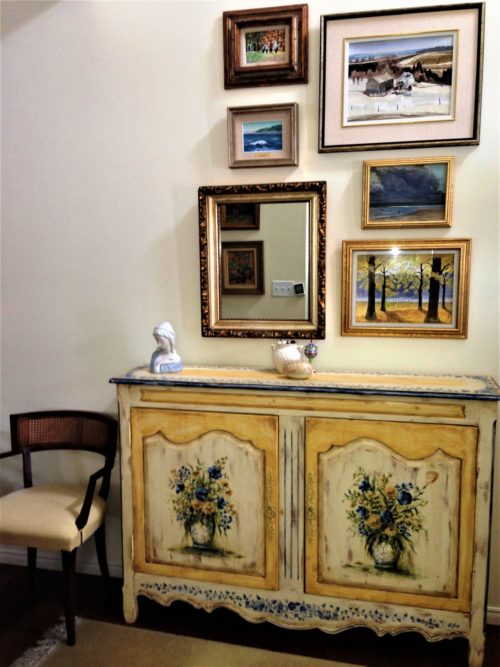 blue and yellow painted sideboard foyer entrance hall gallery wall art hanging
