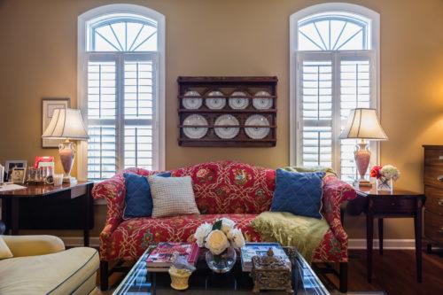 red camelback sofa traditional interior design