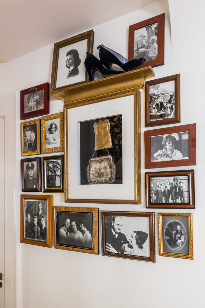 black and white family photos gallery wall salon style