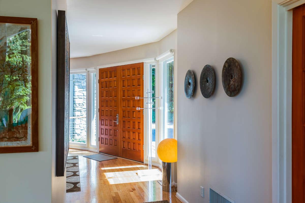 Foyer Design With Wood Paneled Door