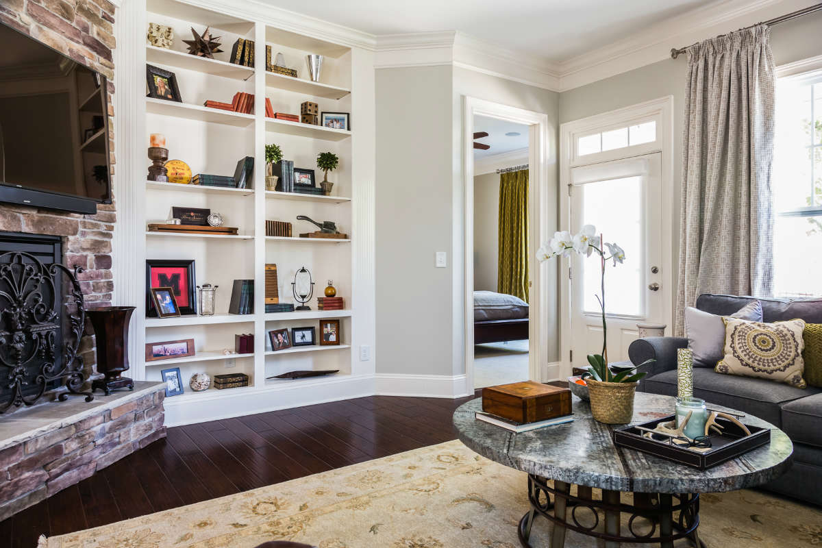 Living Room View Of Master Fireplace And Custom Bookshelves