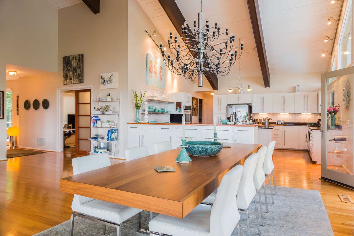 Modern Dining Room And Kitchen Design With Wood Surfaces And Chrome Accents