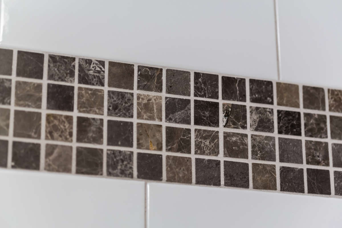 Shower Design With Brown Accent Tile