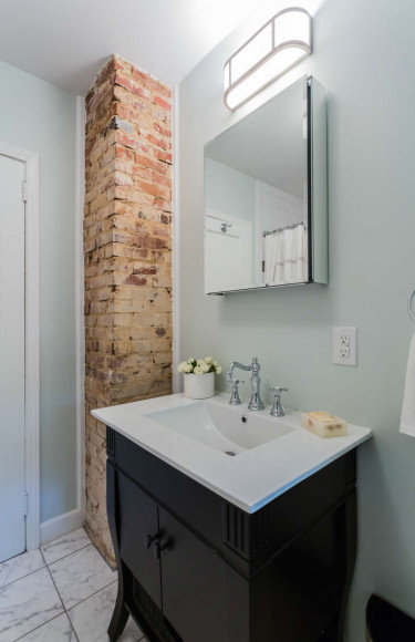 Storage Vanity Cabinet With Exposed Brick Wall