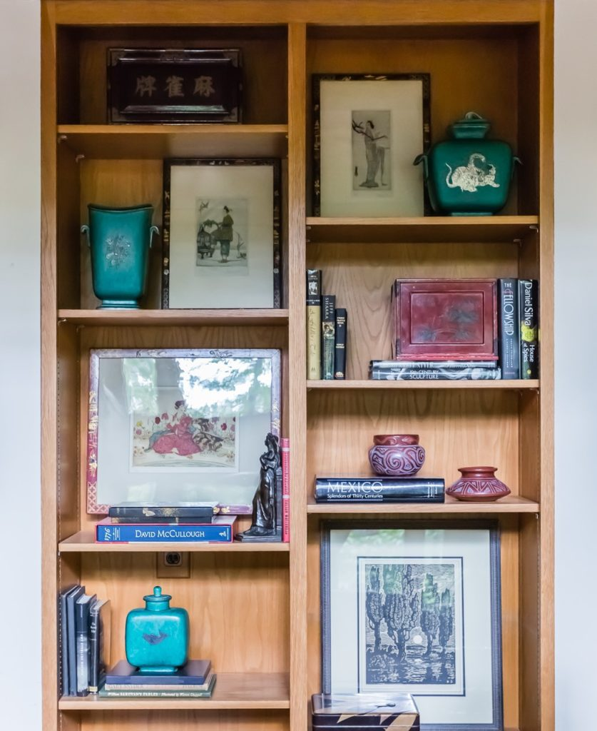 mid century modern bookshelf asian art collection