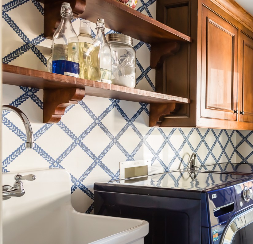 blue and white graphic wallpaper mudroom soap dispensers