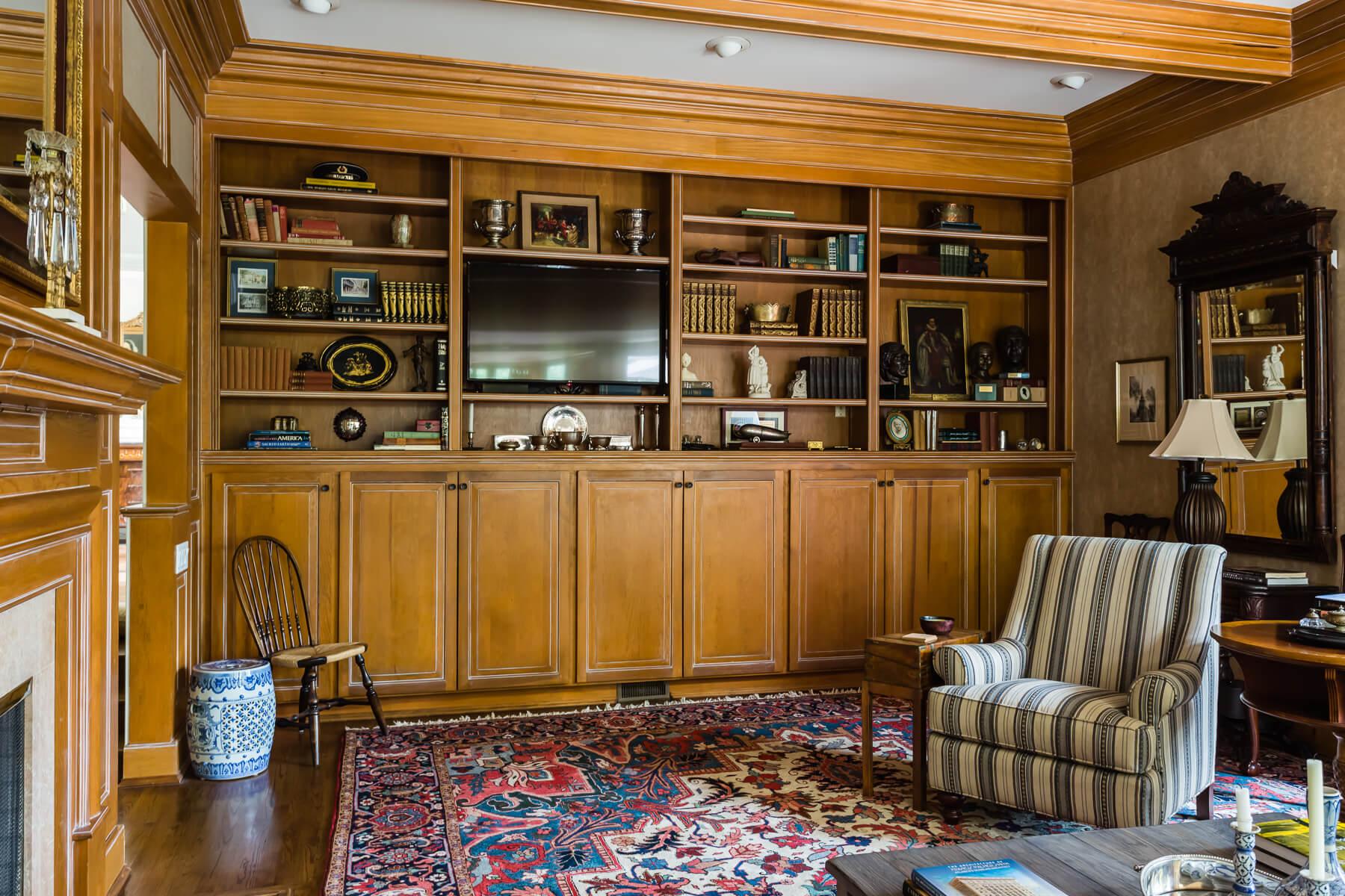 Wood Panel Built In Bookshelves Family Room Library